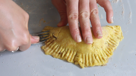 use a knife to press edges of the dough to seal
