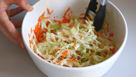 mix shredded cabbage and grated carrots with olive oil and salt and pepper