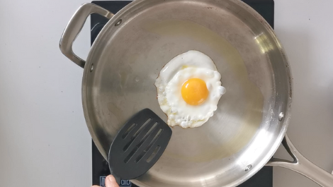 break an egg and slip into pan