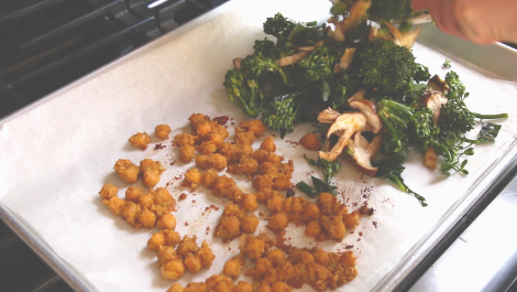 add brassica and mushrooms to one side of the baking sheet with the chickpeas