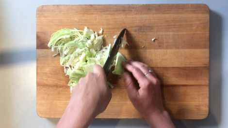 shred the cabbage with a knife